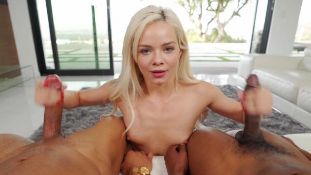 Сучка курит сигарету и выдыхает дым на головку находящегося в ее руках члена